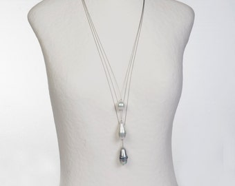 3 in 1 solitaire necklace, is either to unity, or by 2 or 3