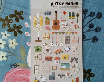 Assorted pretty paper stickers. Kawaii embellishments. Bunny, telephone, socks, flowers, sewing machine, shoes etc. Girl's Emotion
