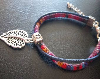 Ethnic bracelet with silver leaf charm
