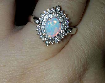 Size 9 lab opal.  Rhodium over SS.