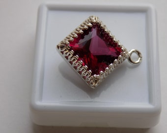 10mm Cherry topaz in a silver pendant