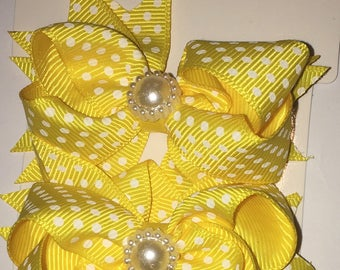 Yellow and white polka dot  shoe bows that come with a magnetic snap to attach to SASSAFLATS shoes they can also be worn in the hair