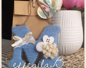Initial letter covered in wool, decorated with pom pom satin felt trina