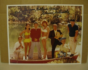 Gilligans Island Photo with Producers Signature in plastic frame suitable for hanging on wall