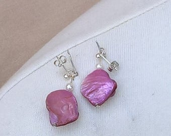 Gorgeous pink shell earrings. Made from recycled materials where possible.