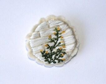 Embroidered brooch on hemp