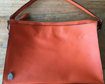 Orange handbag with zipper
