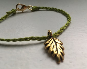 Green braided bracelet with gold leaf
