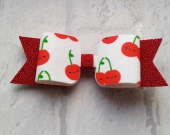 Hand made  cheeky cherry single bow/clip