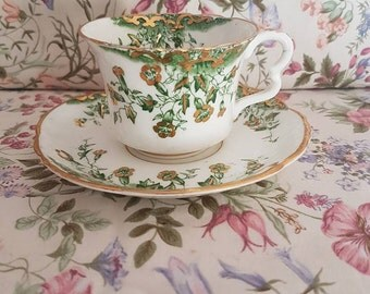 Vintage 1930s Green and gold floral tea cup and saucer