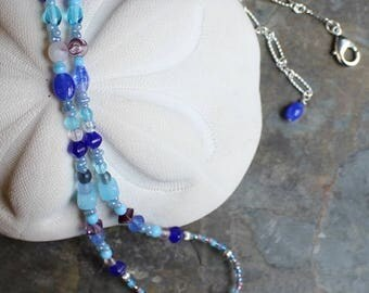 "Necklace with Nunn Design north cascade charm 24"", shades of blue and pastel glass beads, heishi spacers, figaro chain, N031"