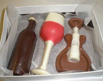 Wine set, truffle filled chocolates, amaretto, chamboard, tawny port, moscato, pinot noir, merlot, champagne cabernet, sauvignon, blueberry