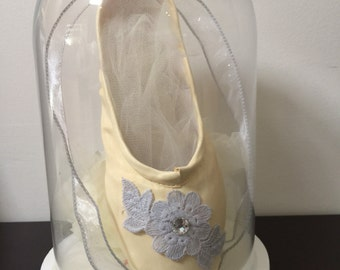 Hand painted pointe shoe displayed in Cloche vase