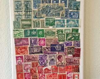 Postage stamps on canvas; blues, greens, reds 8x10