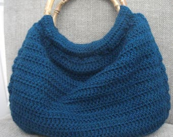 Teal crochet handbag