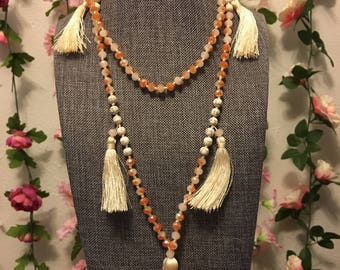 Multi tassel beige beaded necklace