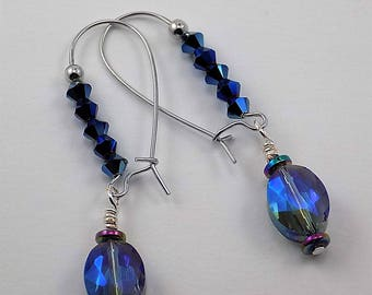 Swarovski crystals in blues, iridescent glass beads, blue, silver, long earrings.