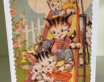 Cute kittens on a slide card