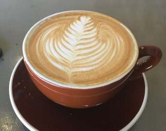 Latte on a brown plate
