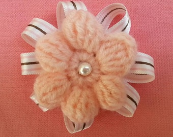 Crochet flower brooch with glass bead