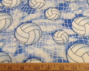 35 inches of Volleyballs on blue background  cotton fabric