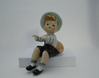 ceramic shelf sitting boy vintage