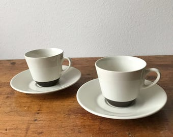 Two Fris Edam Jubilant cups and saucers ivory and engobe