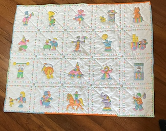 Hand made Baby Quilt with solid pink back and circus theme quilted pattern on front