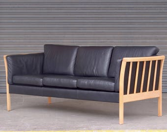 Vintage retro mid century modern Danish sofa three seater 3 person sofa black leather and blonde wooden frame beech