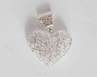 Sunqu Silver Pendant