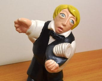 Statuette of the trades. Waiter.