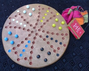 Reversible Solitaire & Tock game board
