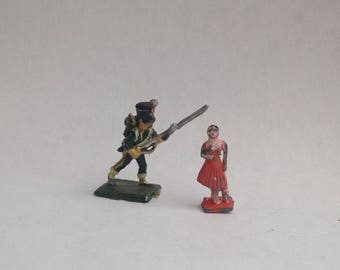 Vintage tiny lead figures soldier and girl 1930s
