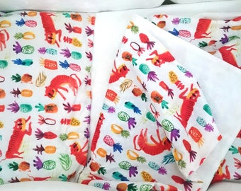 Baby bedclothes with tiger print.