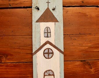little white church painted on wood