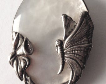 art deco brooch mother of pearl and sterling silver.