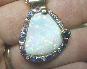 Opal pendant surrounded by sapphires stones with white gold necklace