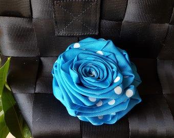 Blue and white ribbon polkadot rosette for Harveys seatbelt bag