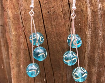 Blue and gold swirl earrings