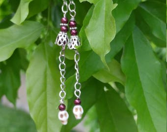 Howlite skull earrings with maroon beads and silver accents