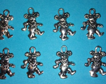 8 Piece Tibetan Silver Charms for Earrings or Necklaces