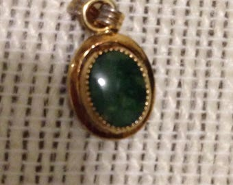 Small gold tone vintage pendant with green stone