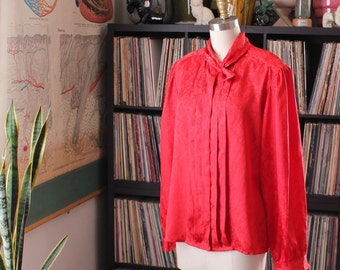 "xl 1x vintage 1980s secretary blouse . shiny red tuxedo blouse with puffy shoulders . 44"" bust"