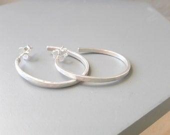 sterling silver oval hoop earrings hammered matte