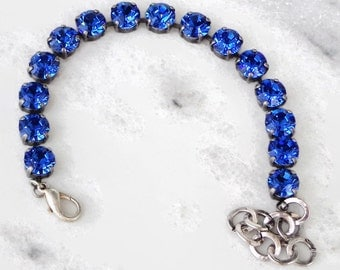 Swarovski crystal 8mm fancy stone tennis style bracelet sapphire blue September birthstones .Antique silver plated setting