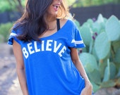 BELIEVE.  Flutter Sleeved Sport Striped Tee.  Holiday/Hanukkah/Christmas Shirt.  Made in the USA.  Several Colors and Print Colors.