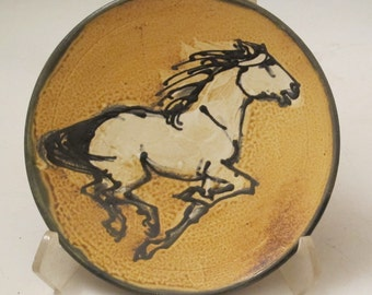 Plate with horse slip trailed pottery plate