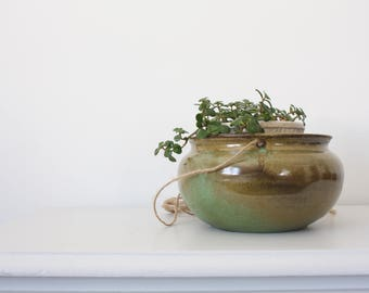 handmade hanging ceramic pottery. planter. earthenware. green. neutral. brown. natural. hand thrown clay. garden.