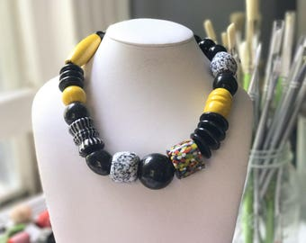 Necklace 2.35 - handmade beaded asymmetrical one of a kind statement necklace featuring vinage lucite wood glass beads black white yellow