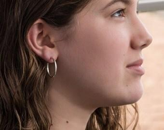 Sterling silver hoop earrings/ 25mm/ Minimal every day hoop earrings/ Simple, classic, narrow hoops/ Hammered silver/ Second piercing